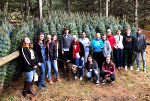 4-H Early College Ag Club in front of Christmas trees